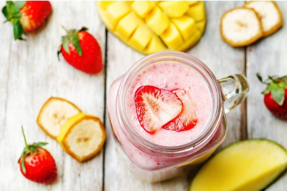 smoothie jar with berries and fruits.