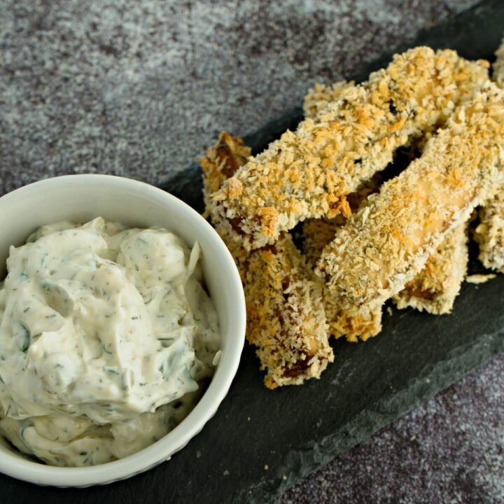 tofu fish sticks with panko bread crumb and a bowl of sauce.