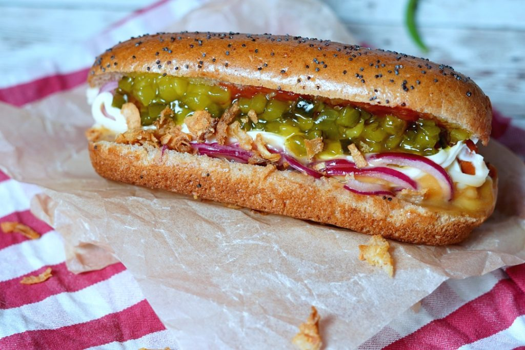 Hot-dog with mayonnaise, picklesalad, ketchup, pickled onions and sweet mustard.