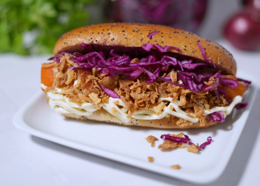 Ikea style hot dog with pickled red cabbage, mayonnaise, sweet mustard and fried onion.