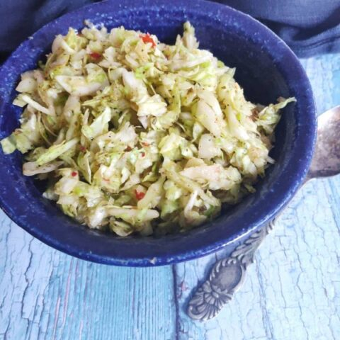 cabbage salad in blue bowl.