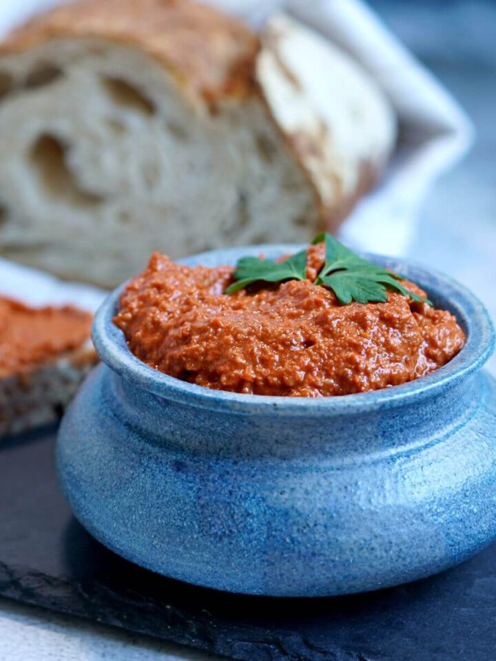blue bowl with spread and loaf.