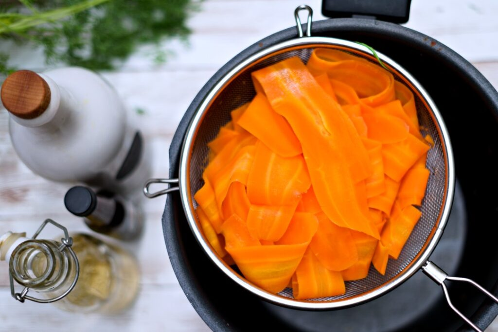 carrot slices in a strainer.