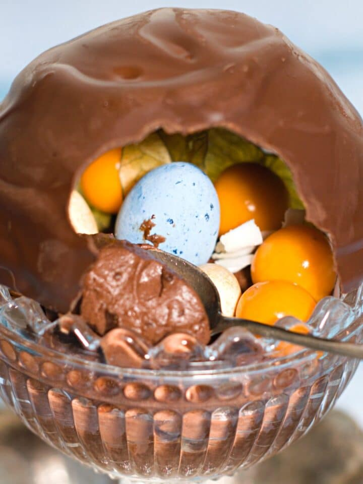chocolate dome filled with chocolate eggs and berries