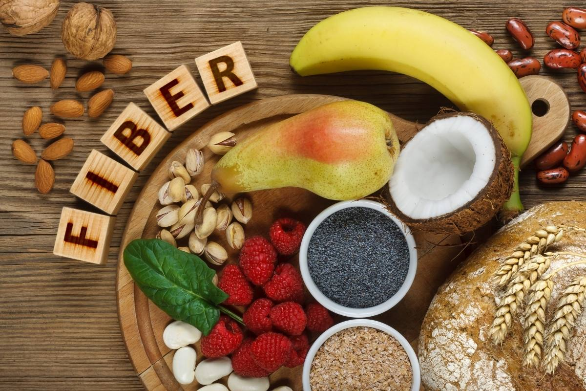 fiber rich foods on a table with text.