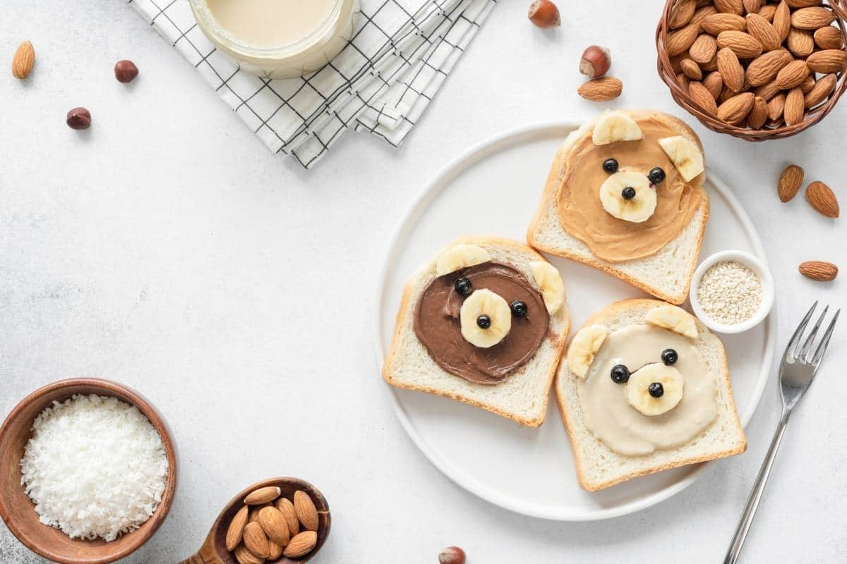 Animal face toasts with nut butter.