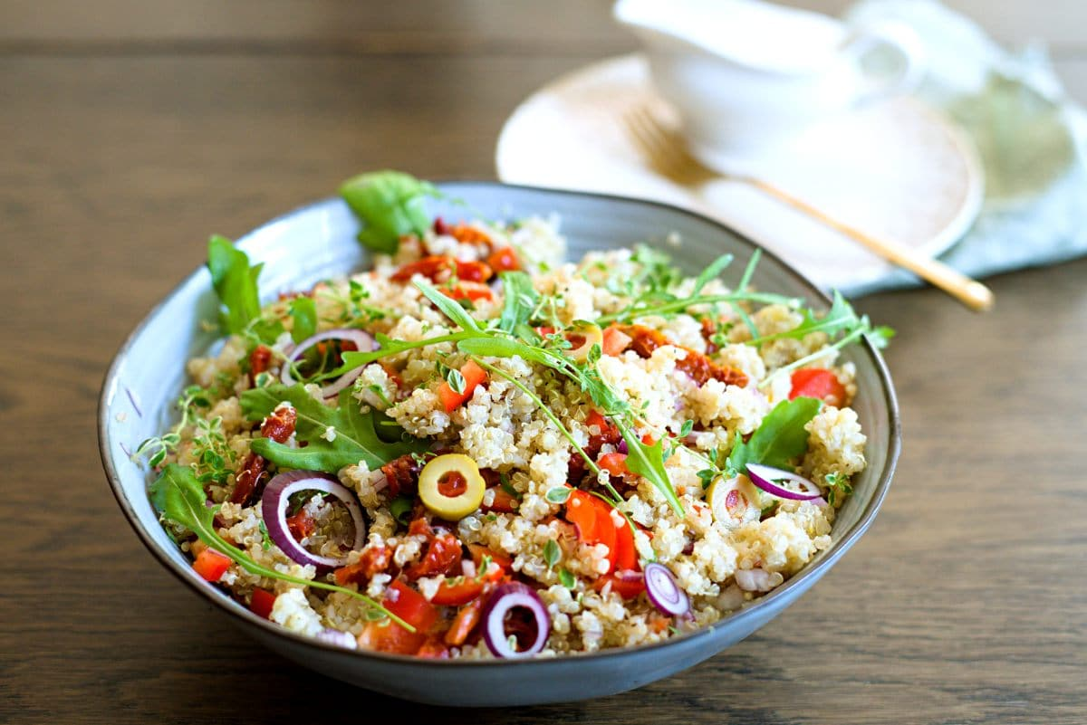 quinoa salad on table with props.